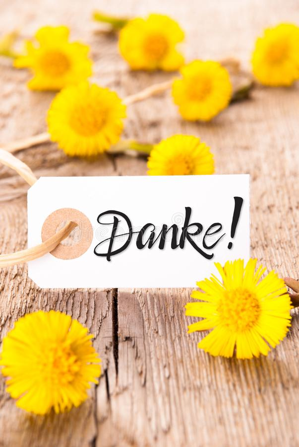 Label, Dandelion, Calligraphy Danke Means Thank You. Label With German Calligraphy Danke Means Thank You. Dandelion Blossom On Wooden Rustic Background stock photo