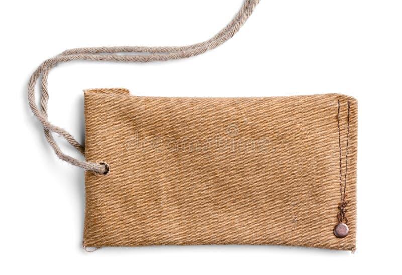 Label de tissu avec le fil sur le blanc photo stock