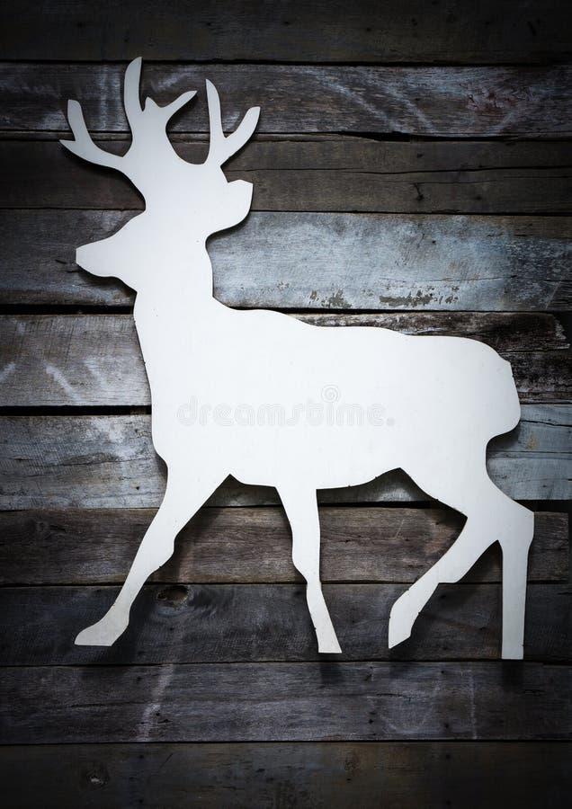 Label en bois blanc de renne sur le fond en bois de planche photos libres de droits