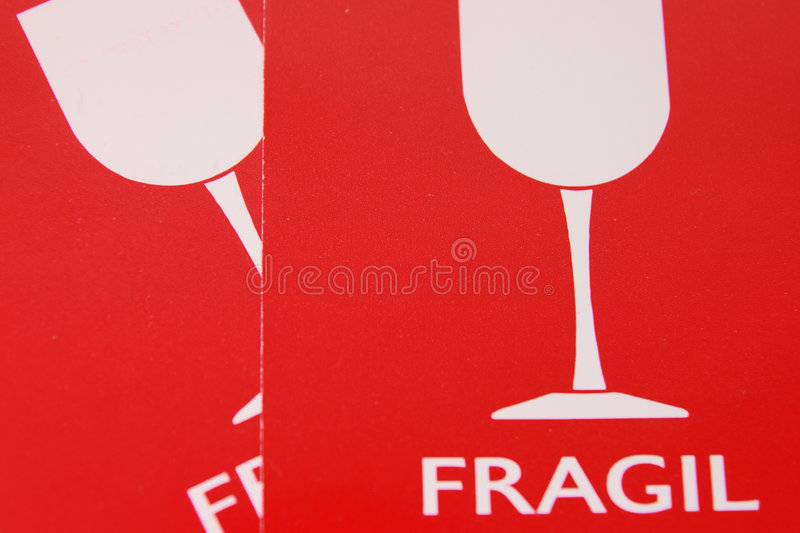 Label fragile. Red label fragile for luggage stock photos