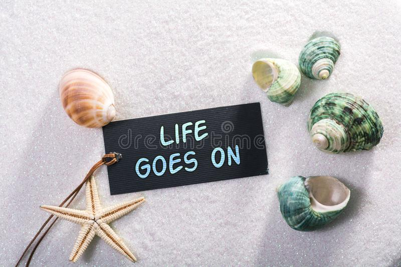 Label with life goes on stock photo