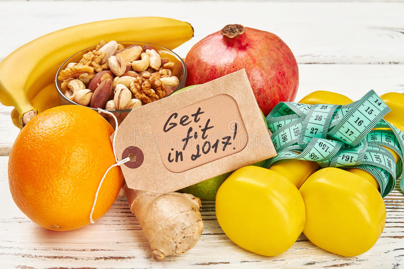 Label, nuts, orange and ginger. Healthy food and sport. Find time for exercise royalty free stock image
