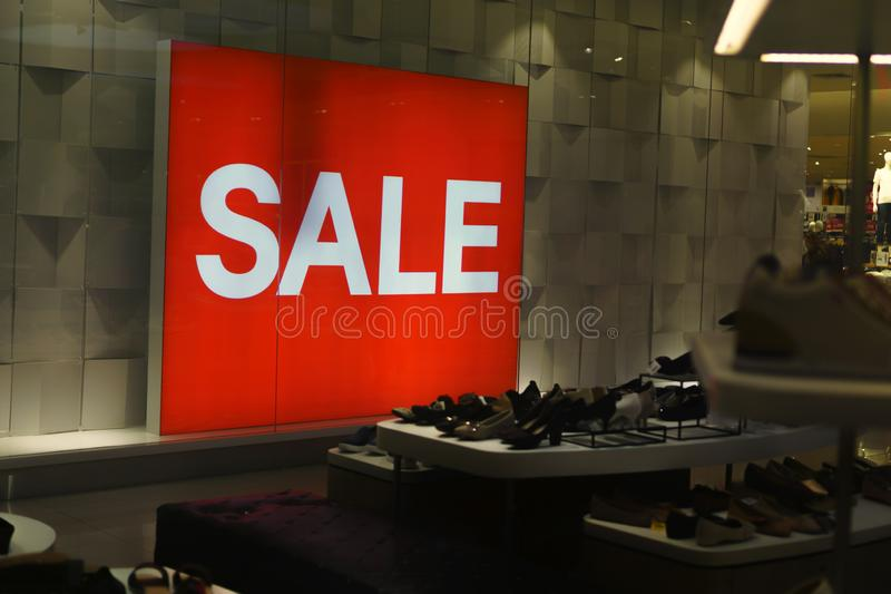Label SALE in the department store - Sale' signs, hanging in a large department store. Department Store, Retail Place, Sale, Shopping Mall, Single Word stock image