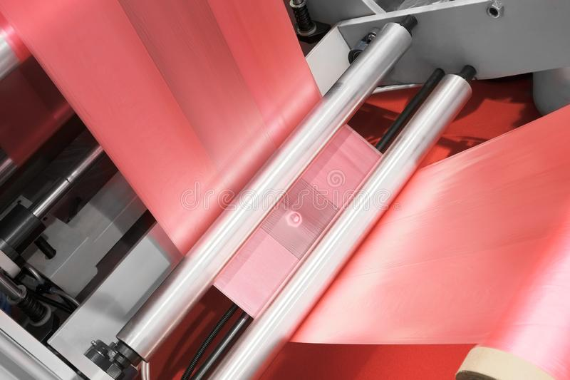 Labels manufacturing on flexo printing machine. royalty free stock photo