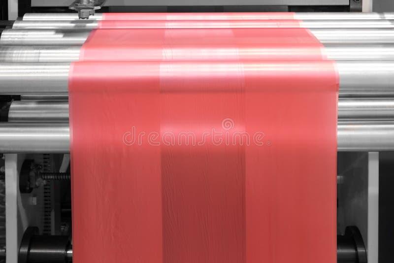 Labels manufacturing on flexo printing machine. stock photo