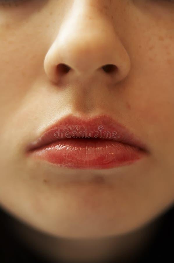 Labios de la muchacha foto de archivo
