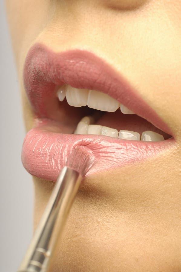 Labios rosados de la mujer fotos de archivo