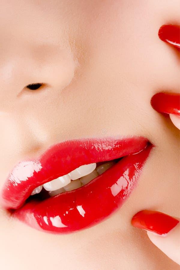 Labios y manicura fotos de archivo libres de regalías
