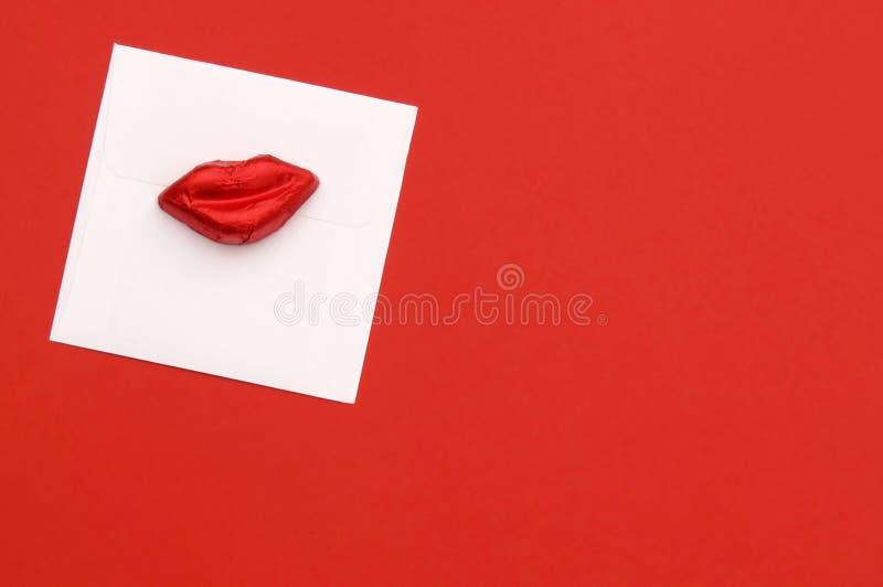 Labios y tarjeta del caramelo de la tarjeta del día de San Valentín imagenes de archivo
