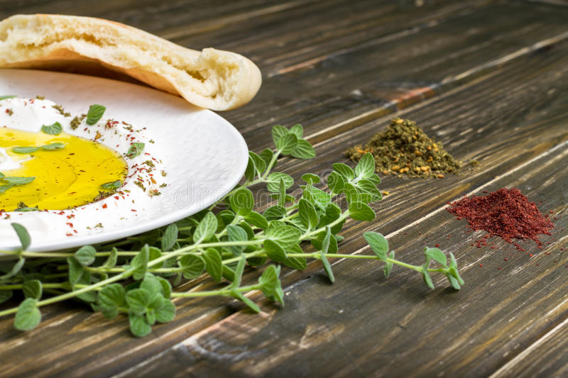 Labneh Strained yogurt with Zaatar. Labneh is a Mediterranean strained yogurt cheese. The Labneh is usually been served with Pita bread and spices such as dried royalty free stock photography