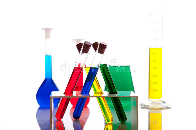 Labolatory glassware with colorful fluids isolated