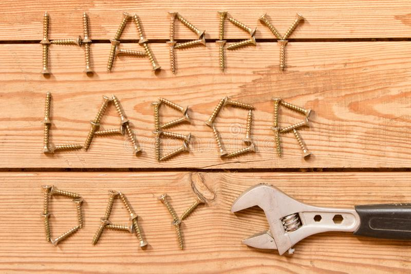 Labor day. Adjustable wrench on wooden background . The concept royalty free stock photography