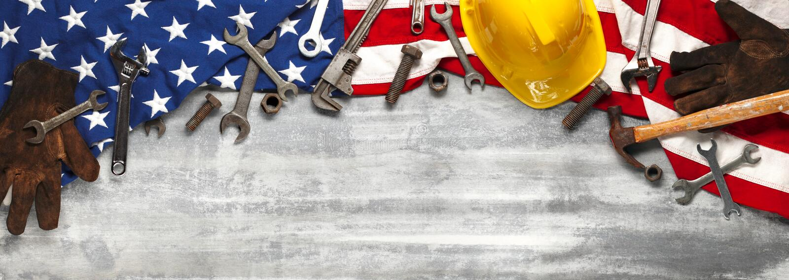 Labor day or American labor concept with construction and manufacturing tools on patriotic US, USA, American flag on wooden. Labor day or American labor concept royalty free stock image