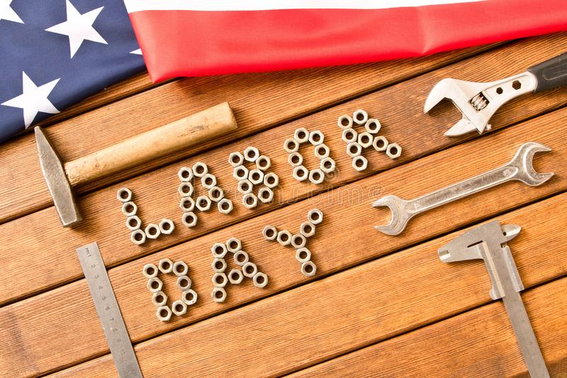 Labor day. American flag. Different tools on wooden background stock photography