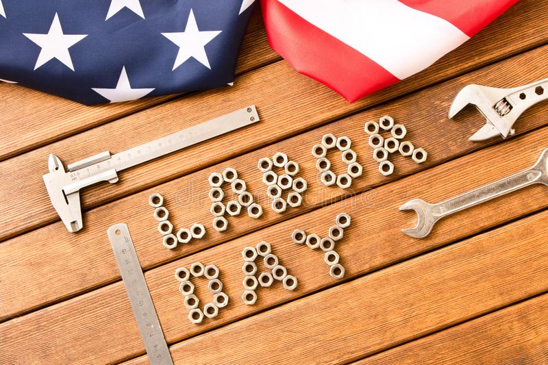 Labor day. American flag. Different tools on wooden background royalty free stock photos