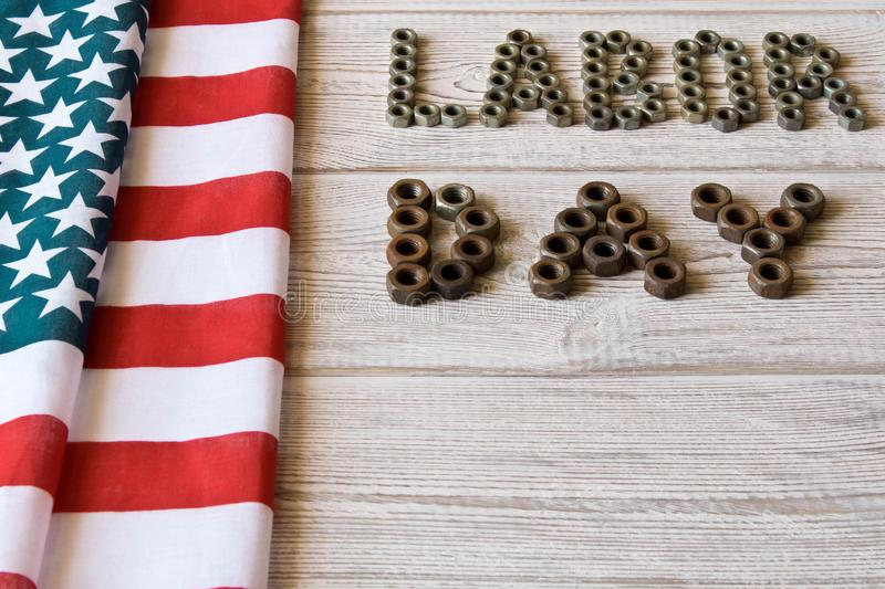 Labor day. American flag and Inscription labor day on a light wooden background stock photos