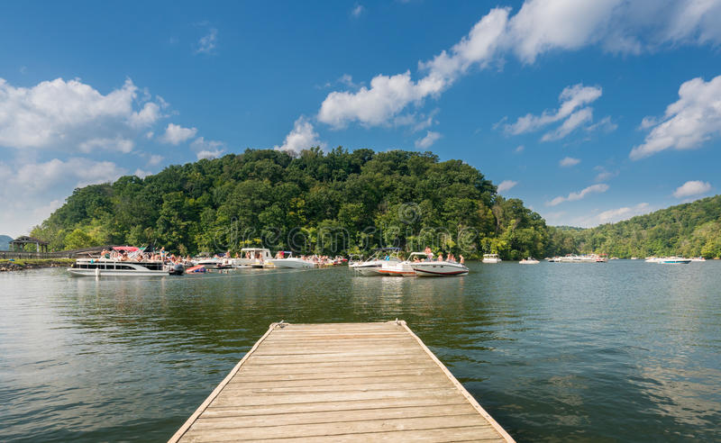 Labor day boating party on Cheat Lake Morgantown WV. MORGANTOWN, WEST VIRGINIA, USA - SEPTEMBER 4: Students and vacationers party on Cheat Lake on September 4 royalty free stock photography