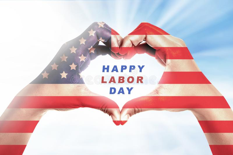 Labor day concept. Human hands in heart shape with american flag skin and Happy labor day message over bright background. Labor day concept stock illustration