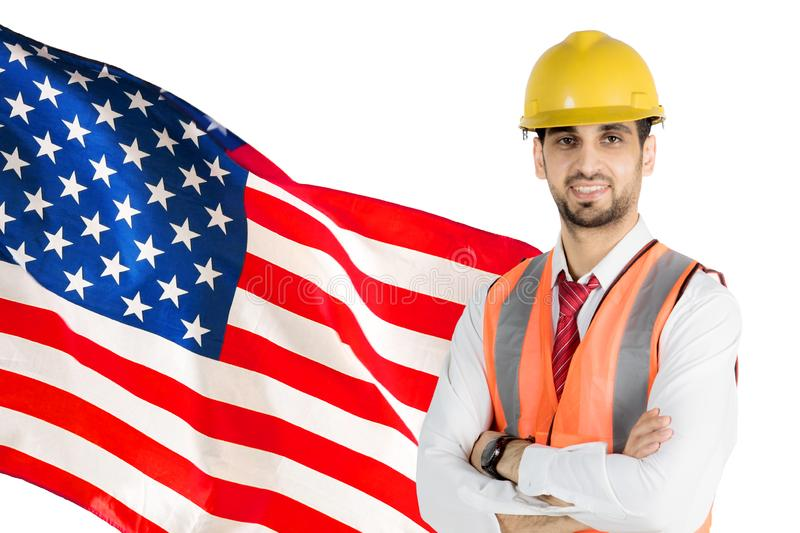 Male engineer standing with an American flag stock images