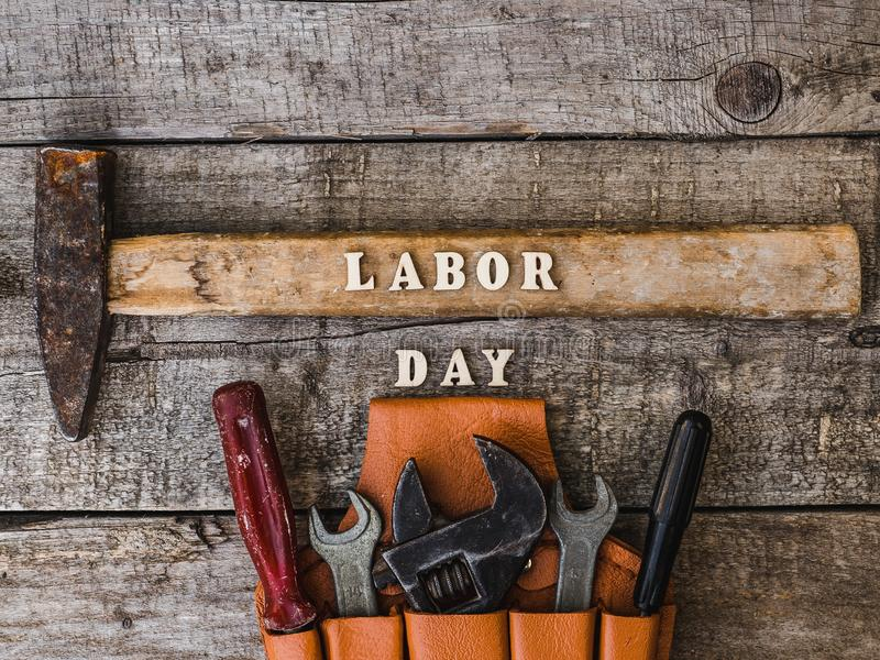 LABOR DAY. Hand tools and wooden letters royalty free stock image