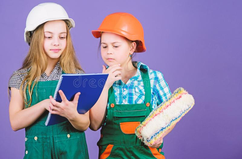 Labor day. 1 may. engineering idea. Foreman inspector. Repair. Little kids in helmet with tablet and roller. small girls stock images