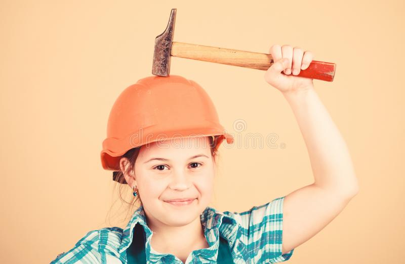 Labor day. 1 may. Safety expert. Future profession. Foreman inspector. Repair. Little girl in helmet with hammer. Kid stock photos