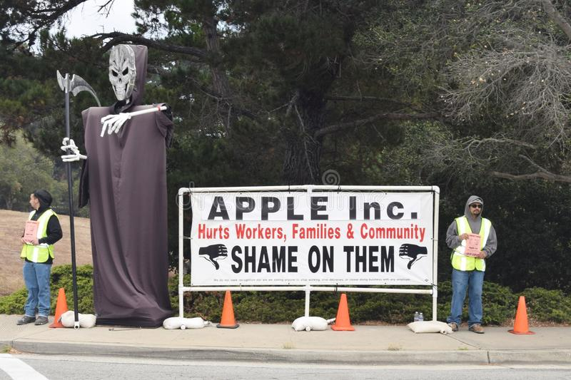 Labor Dispute - Apple Inc. Monterey, California, 8/18/2015: Protesting workers near an Apple Store pass out flyers contending that Apple Inc. has failed to stock image