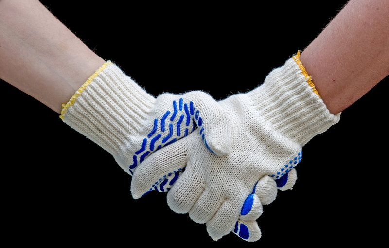 Labor handshake. With safety gloves isolated on black stock image
