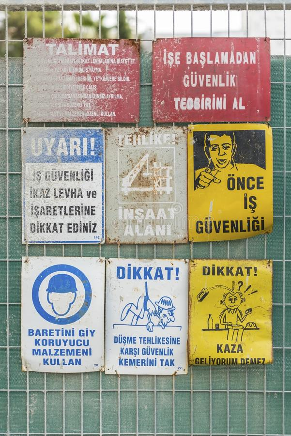 Labor health and work safety warning signs in front of a building under construction , close up stock photo