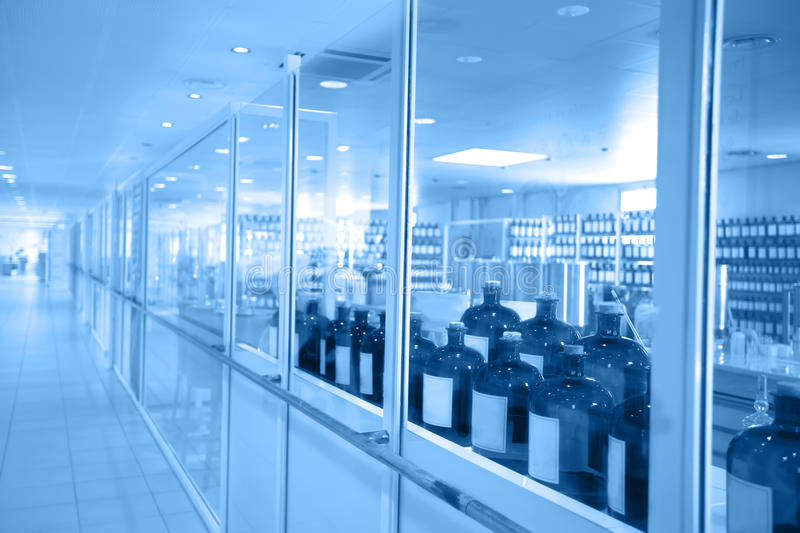 A view to a chemical laboratory through glass windows royalty free stock photo