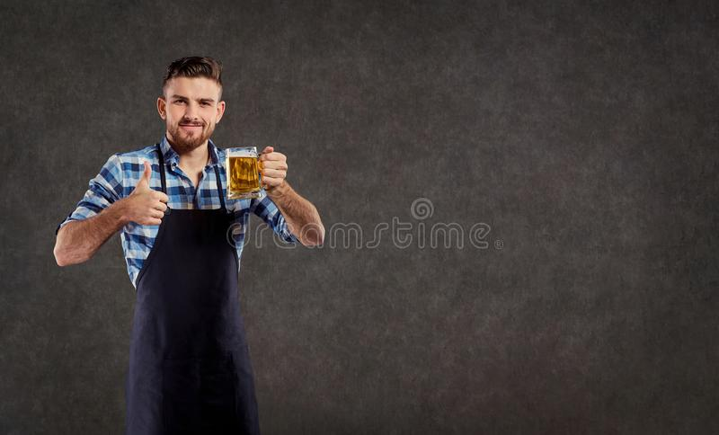 The laboratory assistant brewer winemaker checks the liquid in t. He flask stock photography