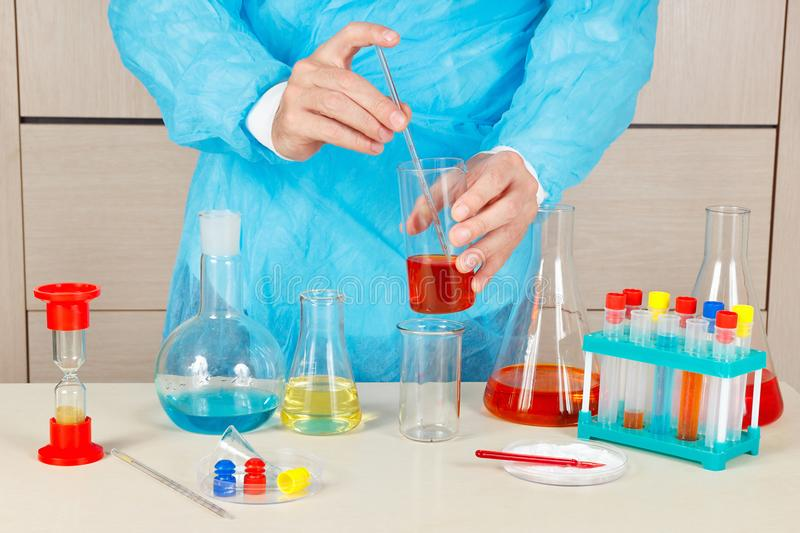 Laboratory assistant is engaged in chemical experiments in laboratory. Laboratory assistant is engaged in chemical experiments in the laboratory royalty free stock photo