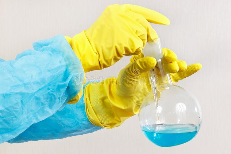 Laboratory assistant hands in rubber gloves is engaged in chemical experiments in laboratory. Laboratory assistant hands in rubber gloves is engaged in chemical stock photos