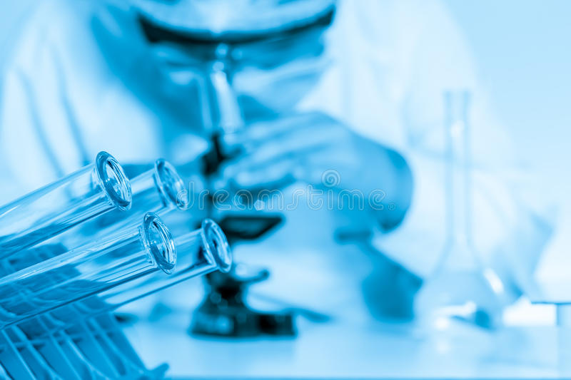 Laboratory assistant working with a microscope stock photography