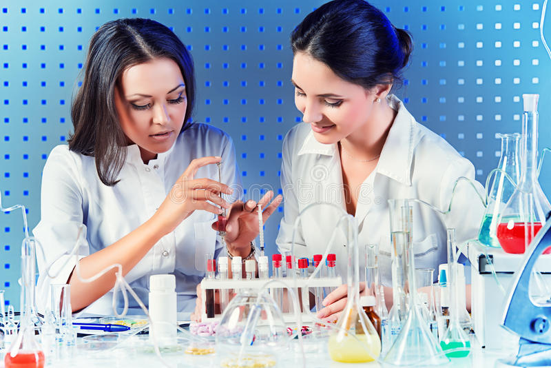 Laboratory assistants royalty free stock photos