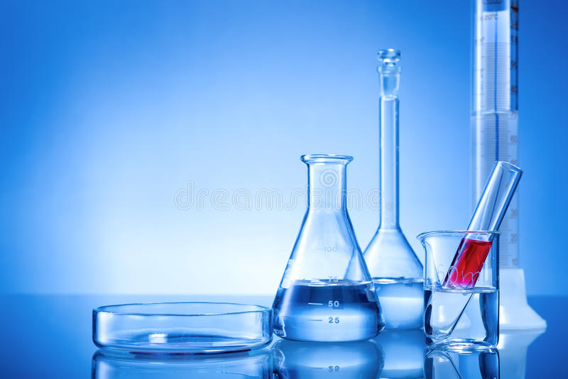 Laboratory equipment, glass flasks, pipettes, red liquid stock photo