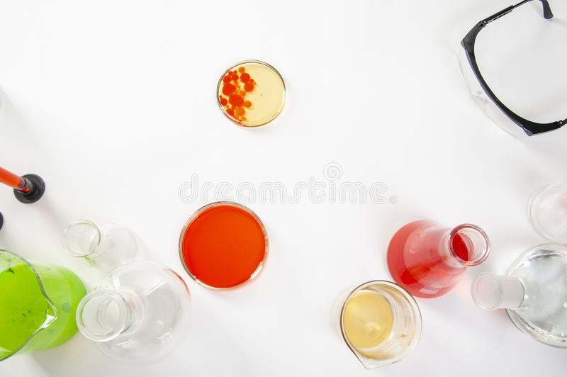 Laboratory equipment on a laboratory table on a white background during the experiments.  stock photography