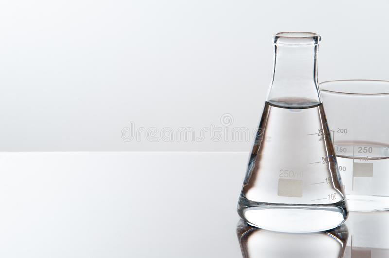 Laboratory equipment on a laboratory table on a white background during the experiments.  royalty free stock image