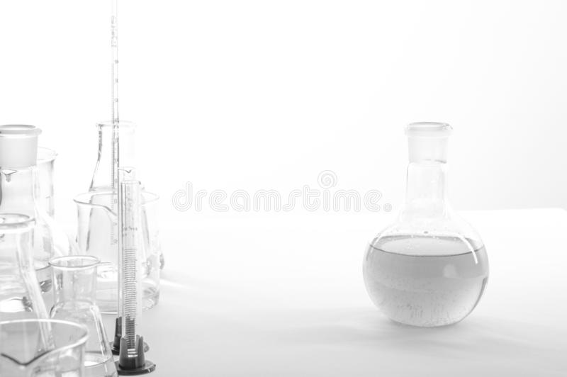 Laboratory equipment on a laboratory table on a white background during the experiments.  royalty free stock photography