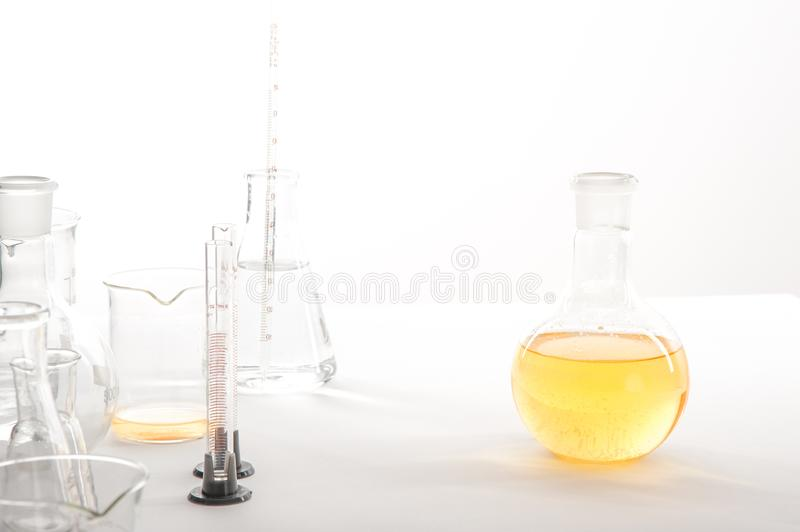 Laboratory equipment on a laboratory table on a white background during the experiments.  stock photo