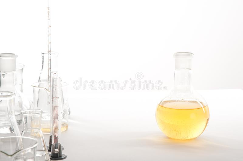 Laboratory equipment on a laboratory table on a white background during the experiments.  stock image