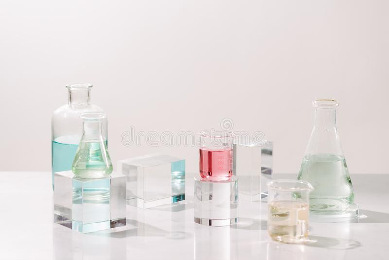 Laboratory experiment and research with leaf,oil and ingredient extract for natural beauty and organic cosmetic skincare product. The blank bottle for label royalty free stock image