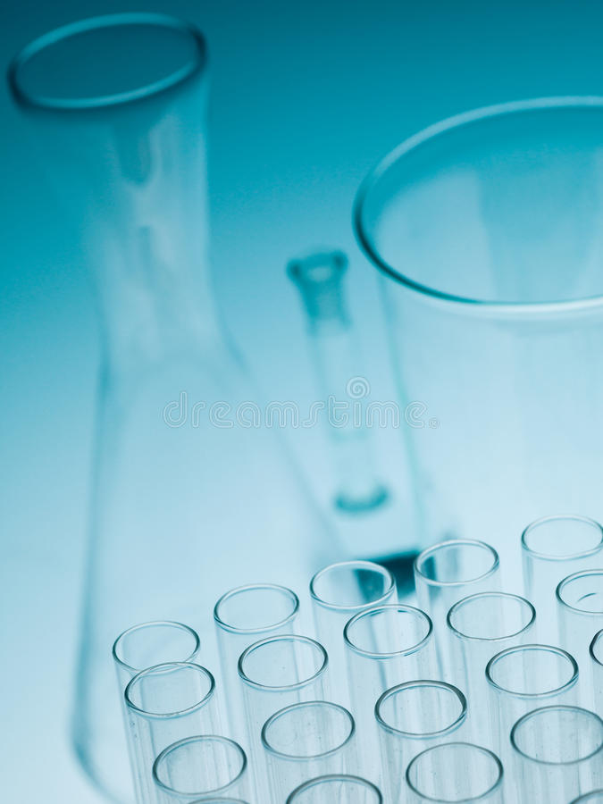 Laboratory experiments glassware on blue gradient background royalty free stock photography