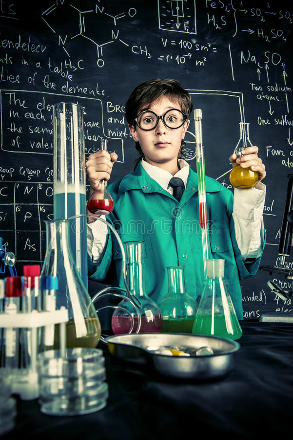 Laboratory experiments for kids. Smart boy scientist making chemical experiments in the laboratory. Educational concept. Discovery stock photos