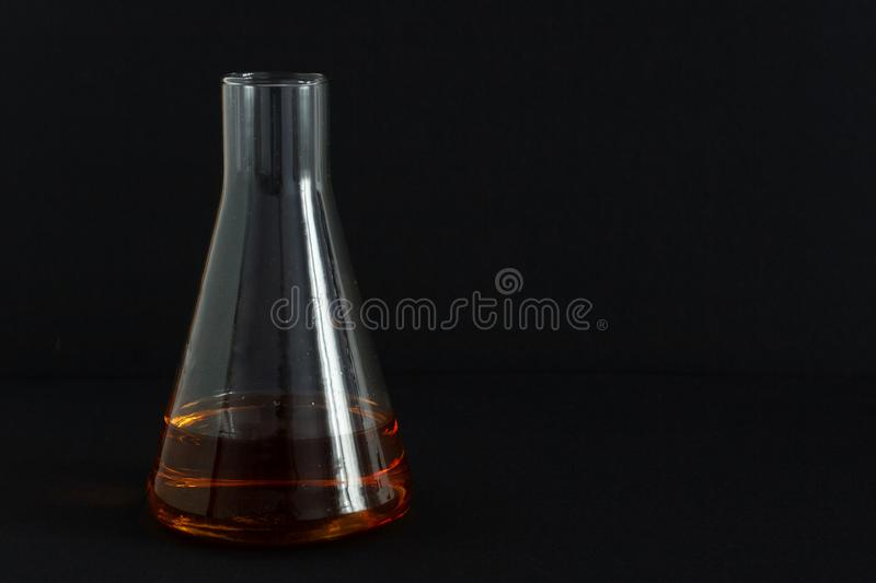 Laboratory for food products analysis, cognac in a chemical glass are taken for a test at the distillery winery for making alcohol. Laboratory for food products royalty free stock photography