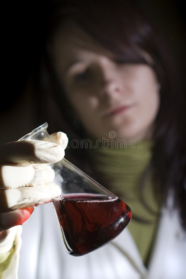 Laboratory glass and woman royalty free stock photos