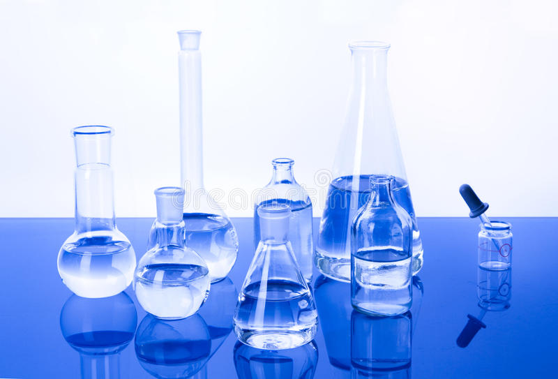 Laboratory Glassware in blue background stock photos