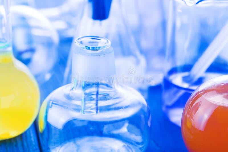 Laboratory glassware on blue background. stock photography