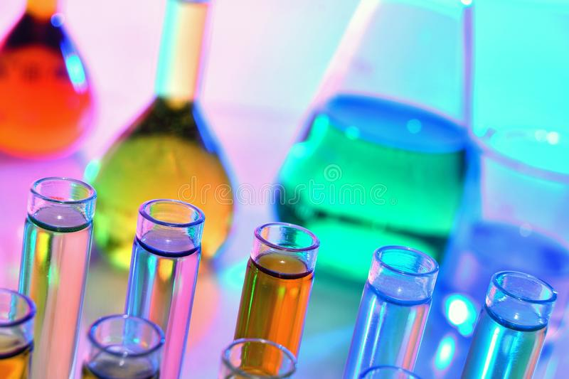 Laboratory glassware with colorful chemicals, chemistry science royalty free stock images