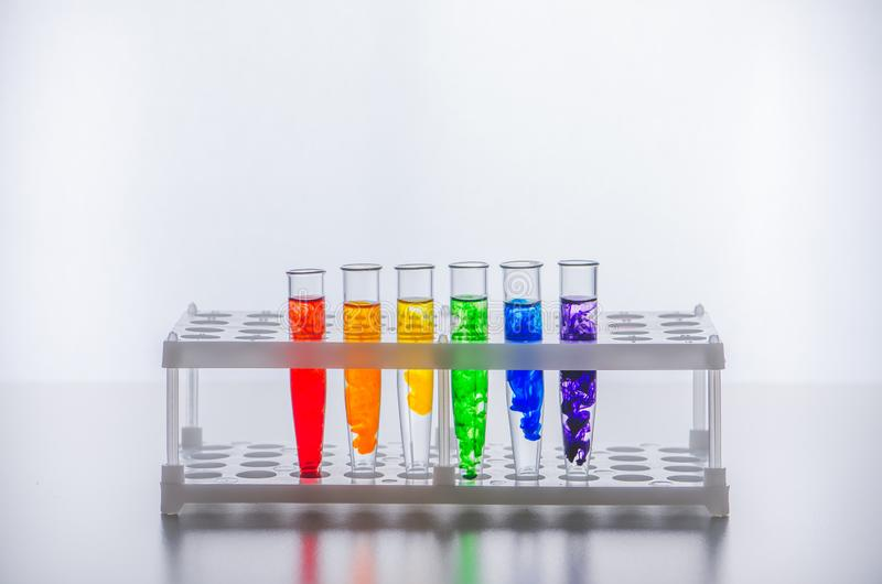 Glassware. Test tubes with a multi-colored liquid. Chemical reaction. The study of chemistry at school. royalty free stock photography